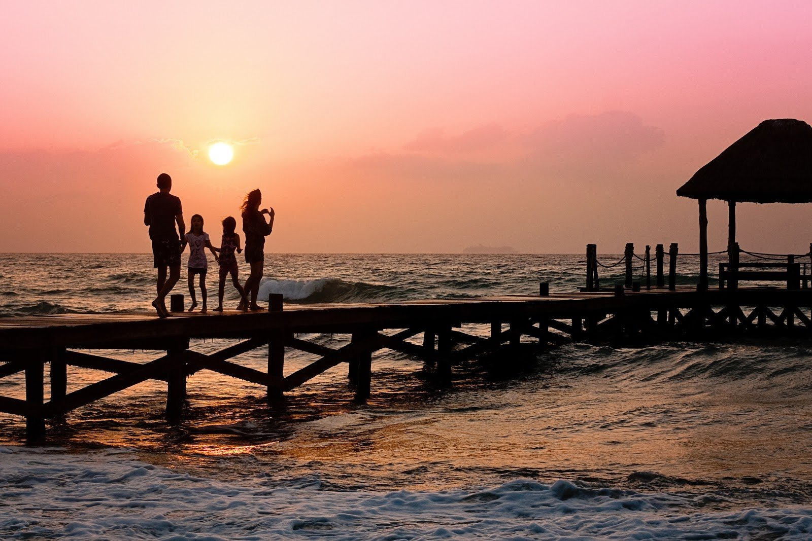 Family on a bridge with sunset
