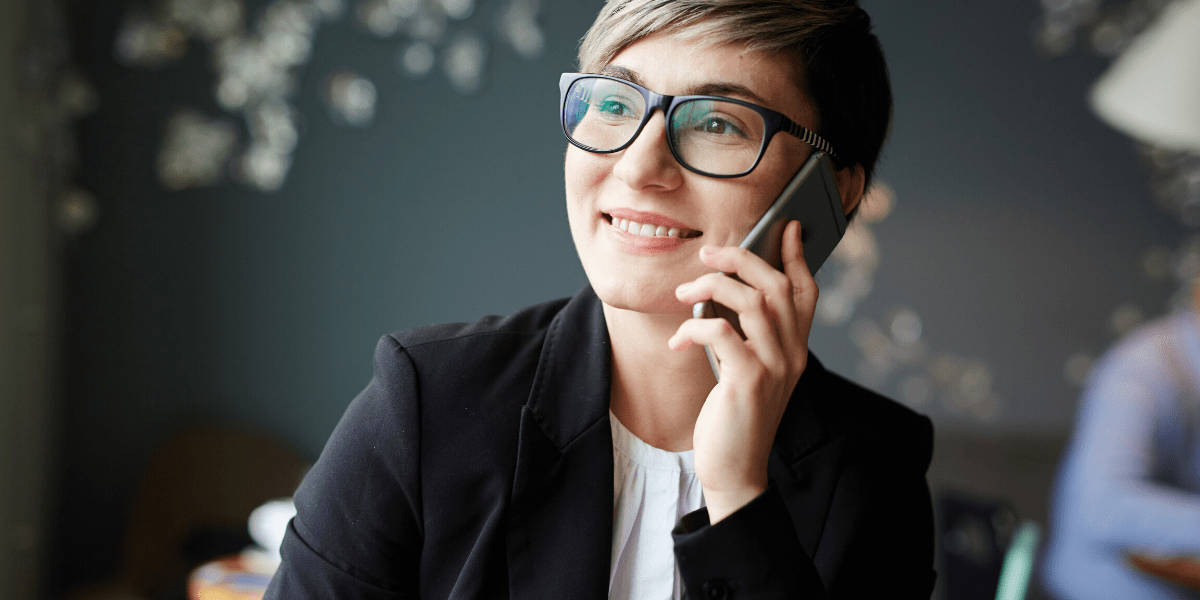 Direct Sales Consultant working from Home with Telephone in Hand