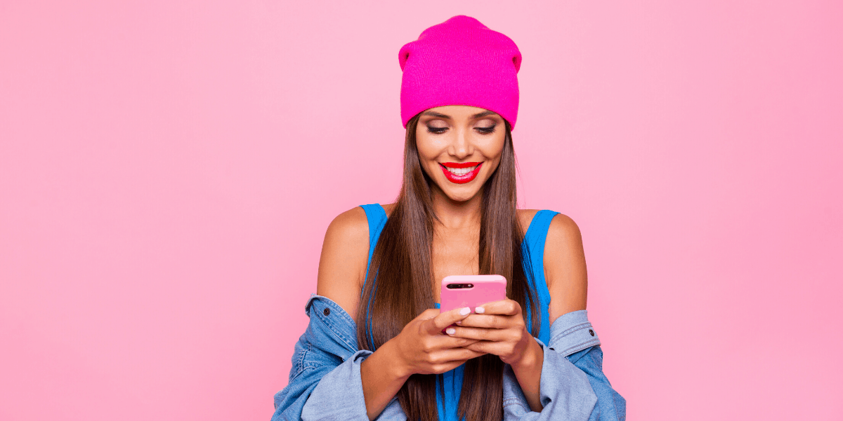 Woman making Money on Instagram with her pink Smartphone