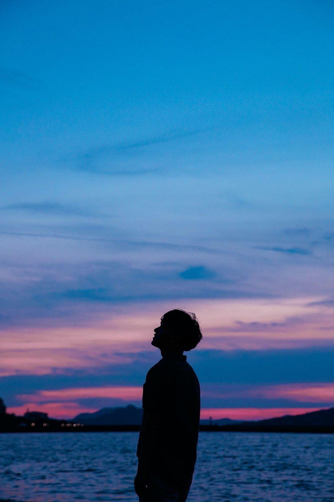 Man looking into sky