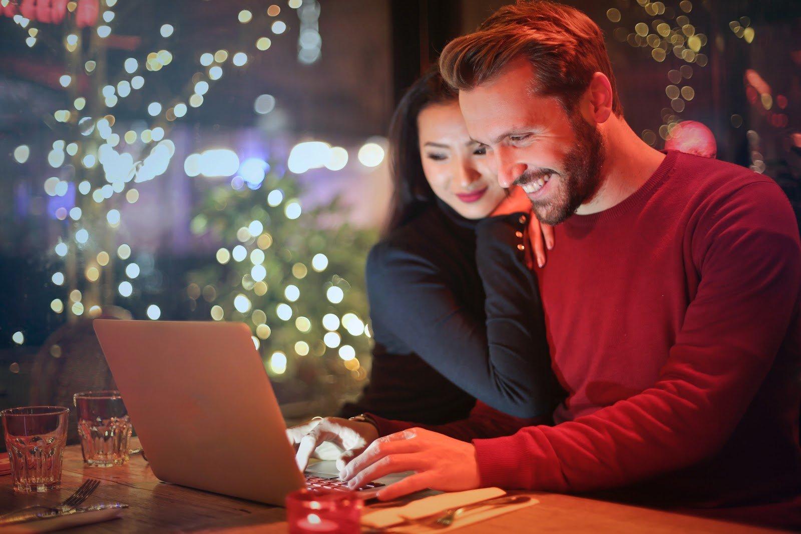 man woman looking at laptop