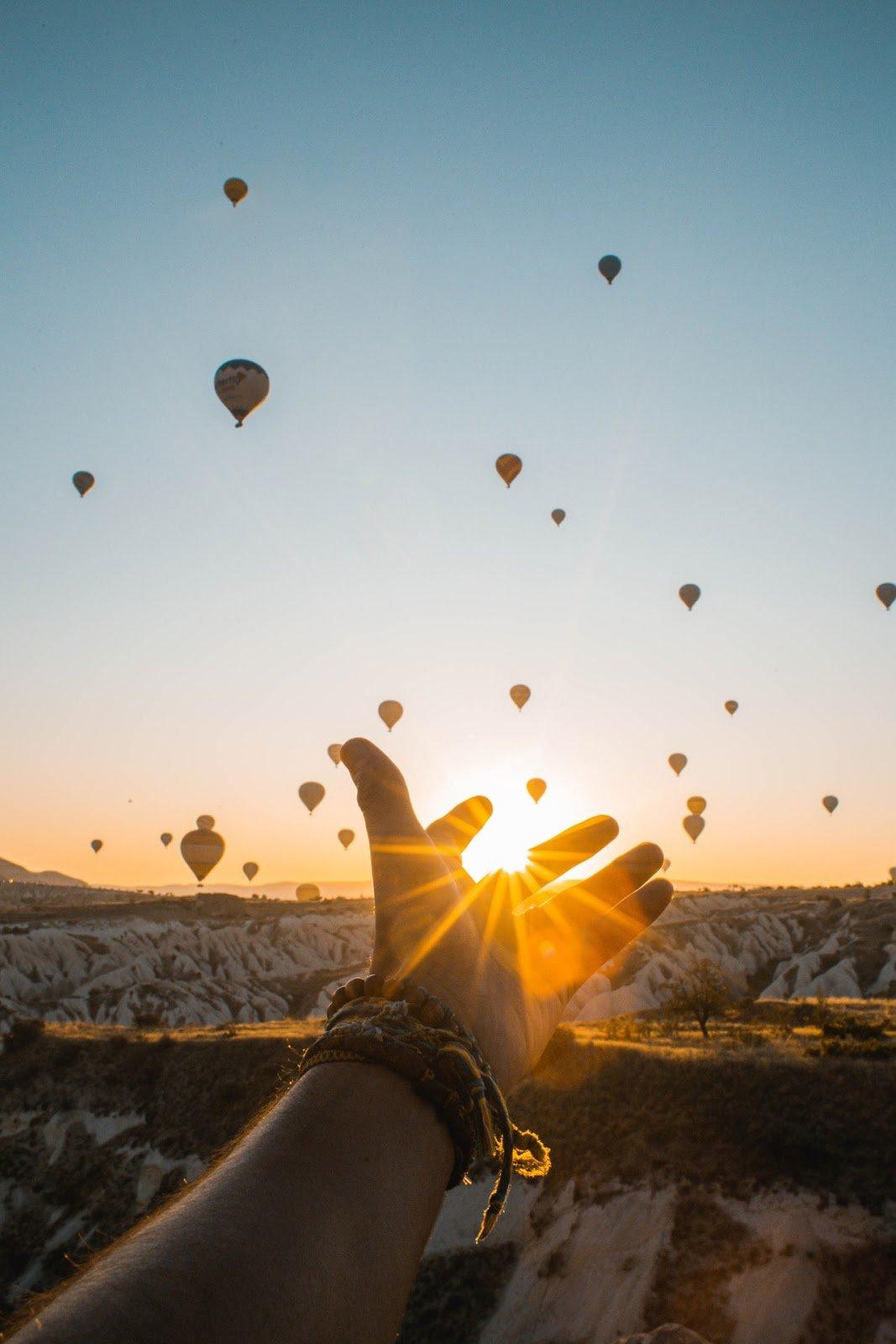 Balloons flying in sky