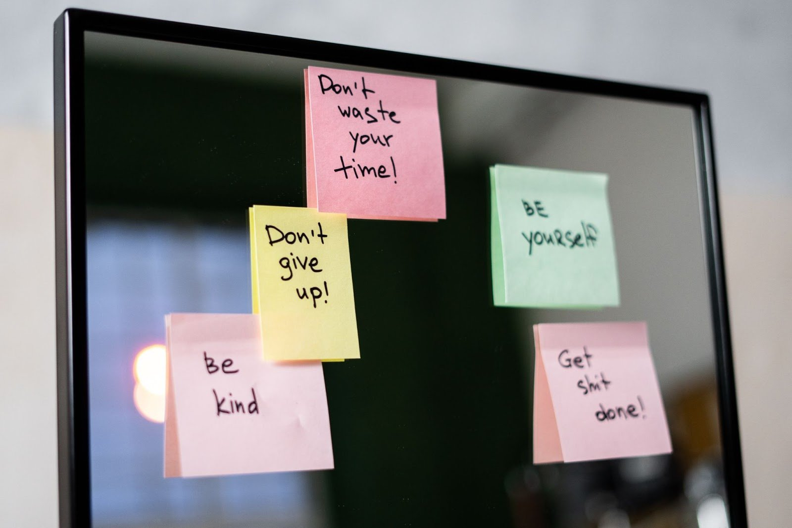 Positive post its on a screen