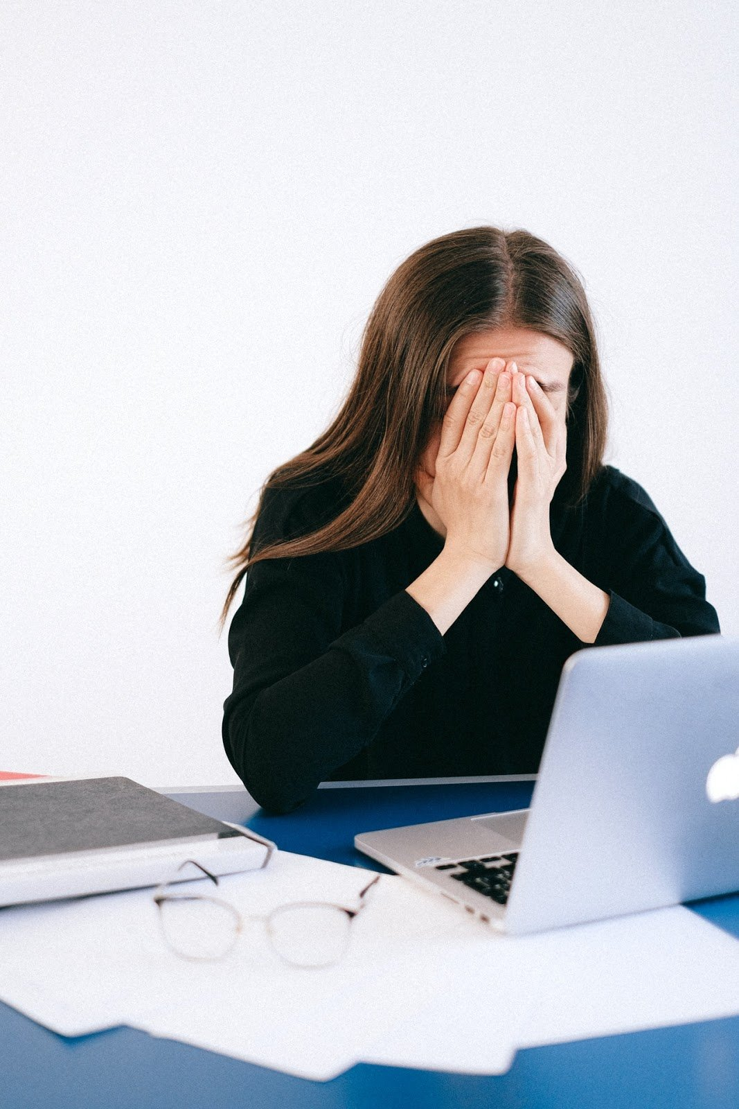 Frustrated woman with laptop