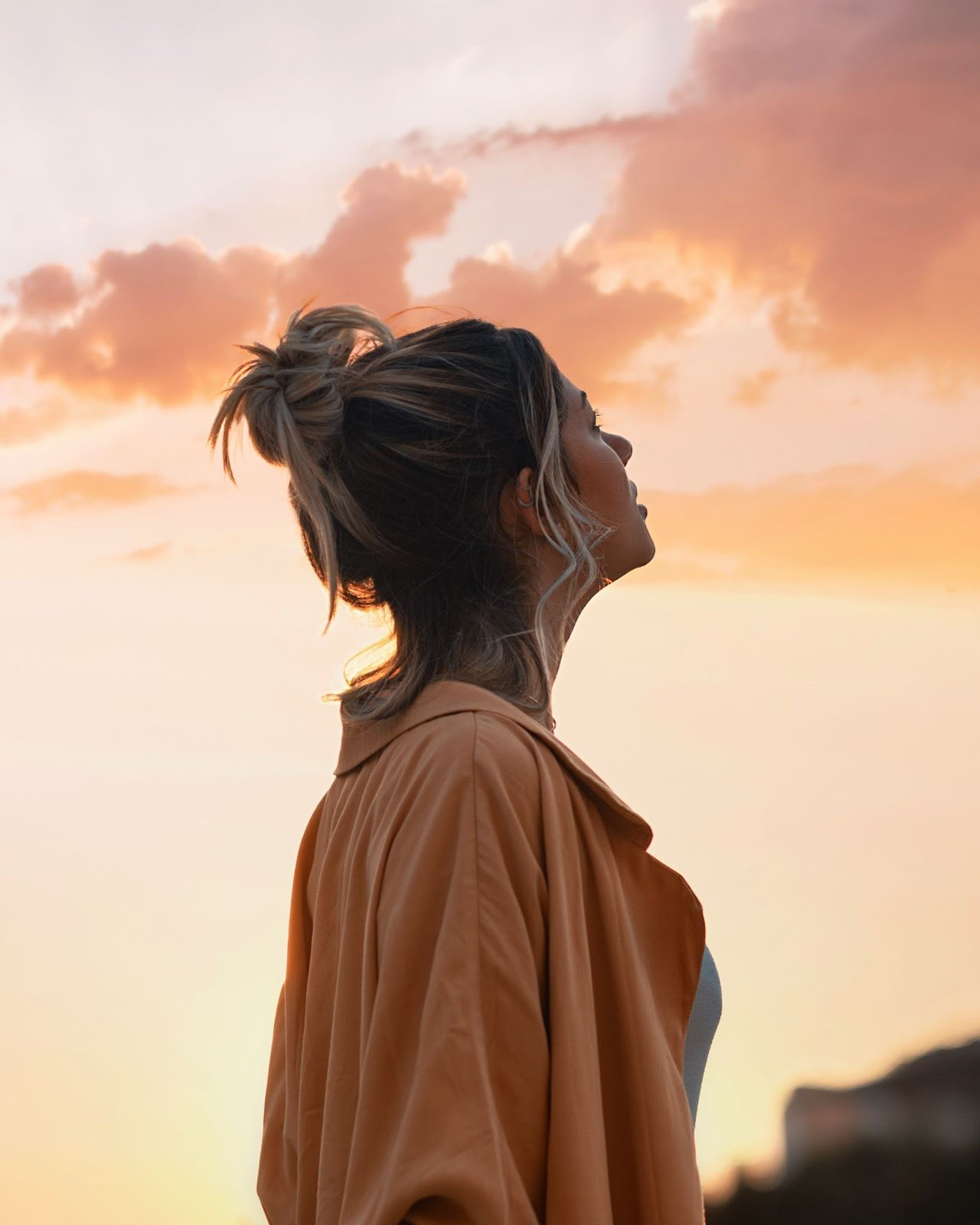 Woman looking into the sky